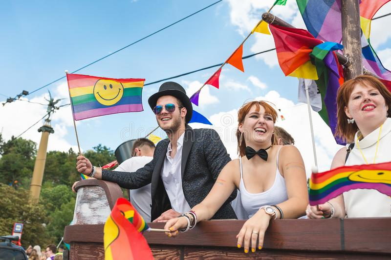 People at the annual Prague Gay Pride parade. Man and women on a car smiling and dancing. Prague, Czech Republic - August 11, 2018: People at the annual Prague stock photography