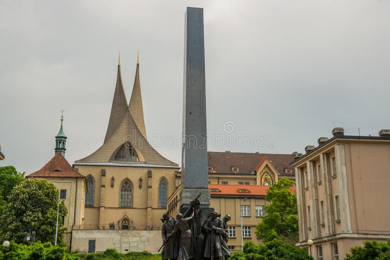 Prague, Czech Republic: The Church of saints Cosmas and Damian and monument royalty free stock images
