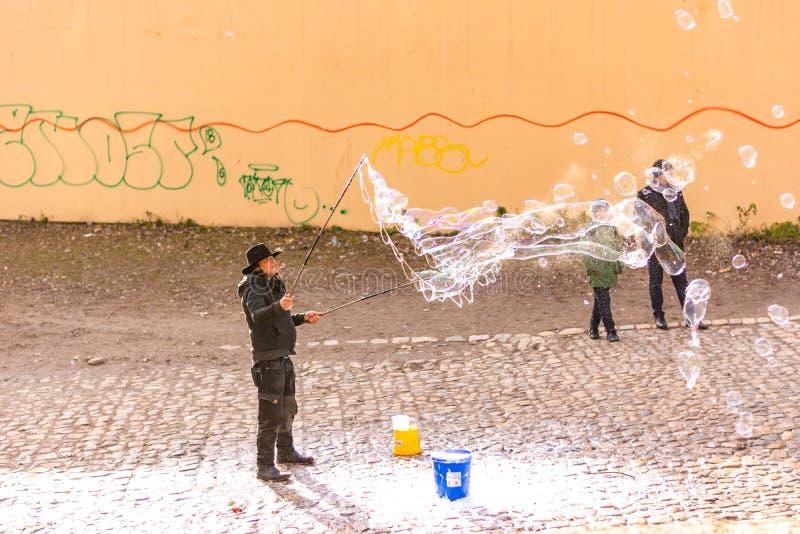 PRAGUE, CZECH REPUBLIC - 8.12.2018: Bubble artist is making soap bubbles on Prague city street royalty free stock photo