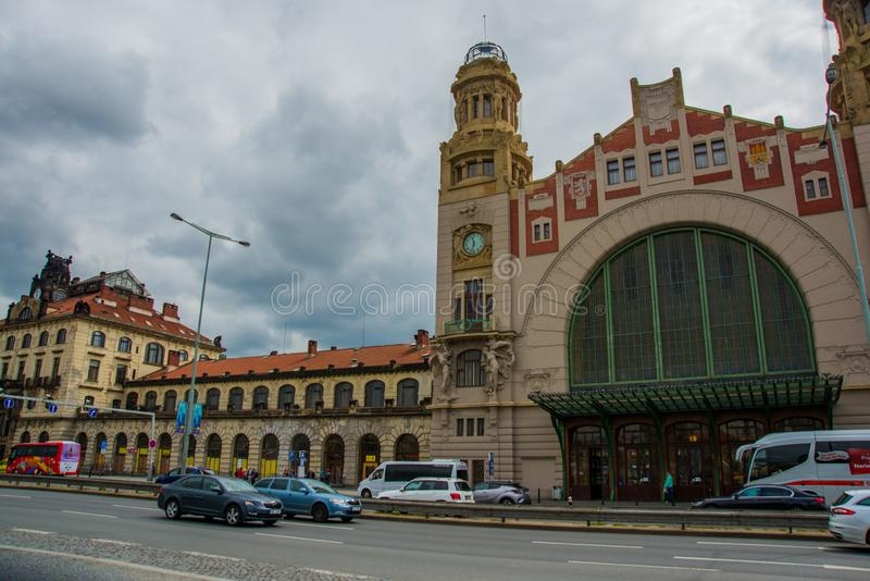 Prague, Czech Republic: Train station historical building in Prague, Czech Republic. Prague, Czech Republic: Cars passing by the main and biggest railway station royalty free stock images