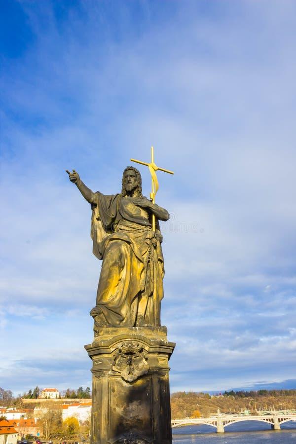 Prague, Czech Republic - December 31, 2017: The gothic sculpture of the John the Baptist on the Charles bridge. Prague, medieval art, statue of Saint on the royalty free stock photos