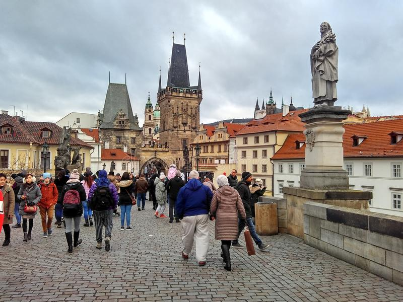 Prague, Czech Republic - December 24, 2017, many tourists on the Charles Bridge. Prague, Czech Republic - December 24, 2017, a lot of tourists on the Charles stock image