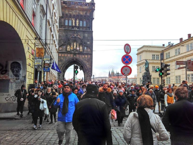 Prague, Czech Republic - December 24, 2017, many tourists on the Charles Bridge. Prague, Czech Republic - December 24, 2017, a lot of tourists on the Charles royalty free stock image