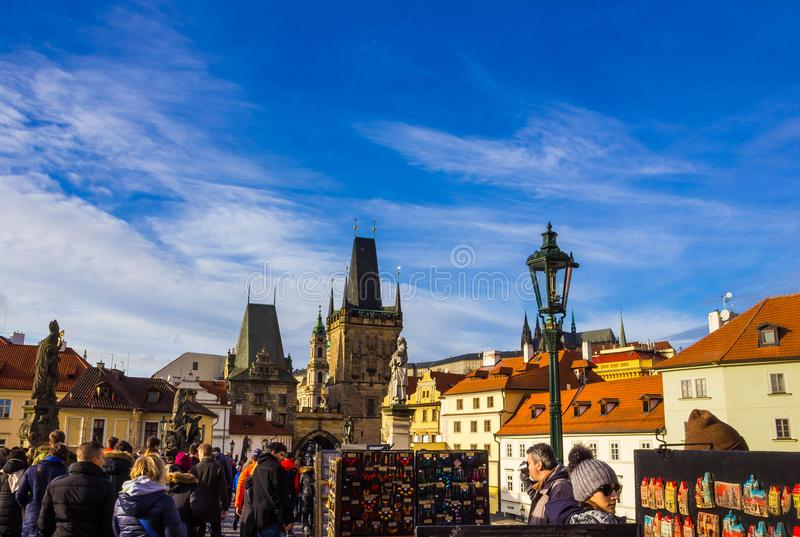 Prague, Czech Republic - December 31, 2017: People walking on the historic Charles Bridge royalty free stock images