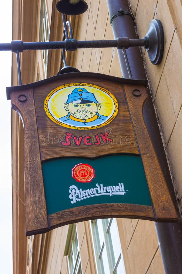 Prague, Czech Republic - December 31, 2017: The street sign at main entrance to Svejk beer pub. At Prague, Czech Republic - December 31, 2017 royalty free stock photography