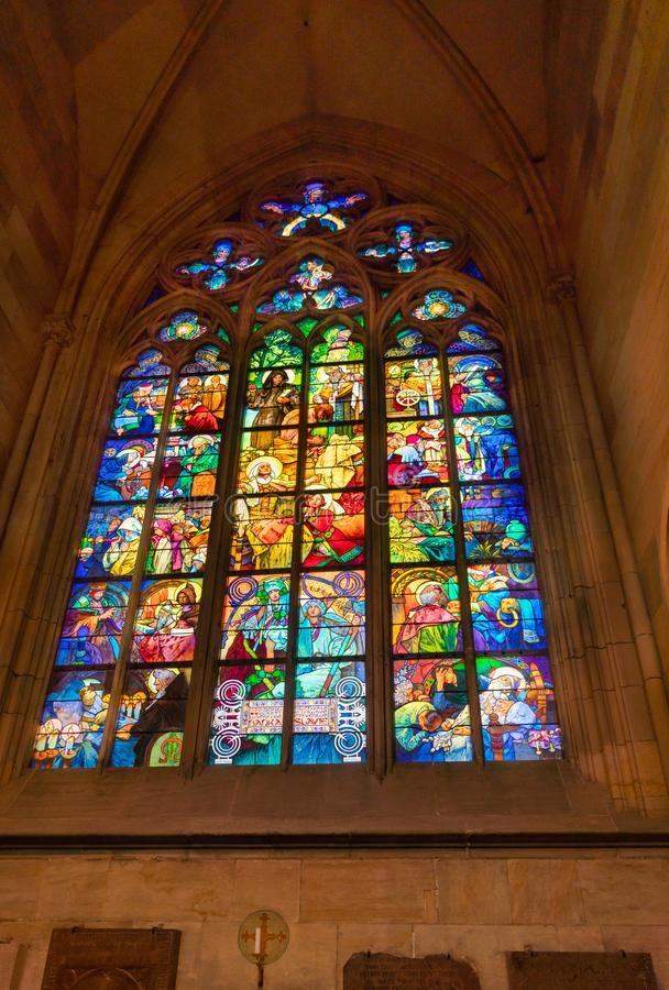 Stained glass window at St. Vitus Cathedral in Prague royalty free stock photography
