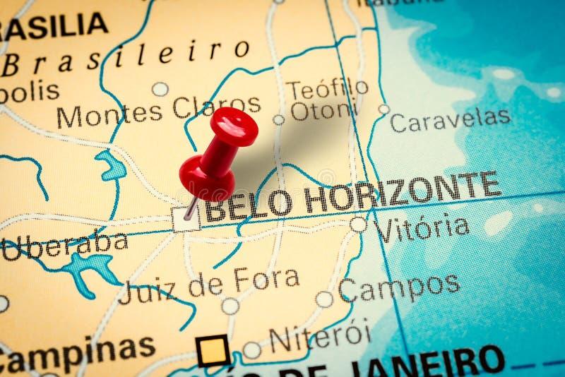 Pushpin pointing at Belo Horizonte city in Brazil. PRAGUE, CZECH REPUBLIC - JANUARY 12, 2019: Red thumbtack in a map. Pushpin pointing at Belo Horizonte city in royalty free stock photo