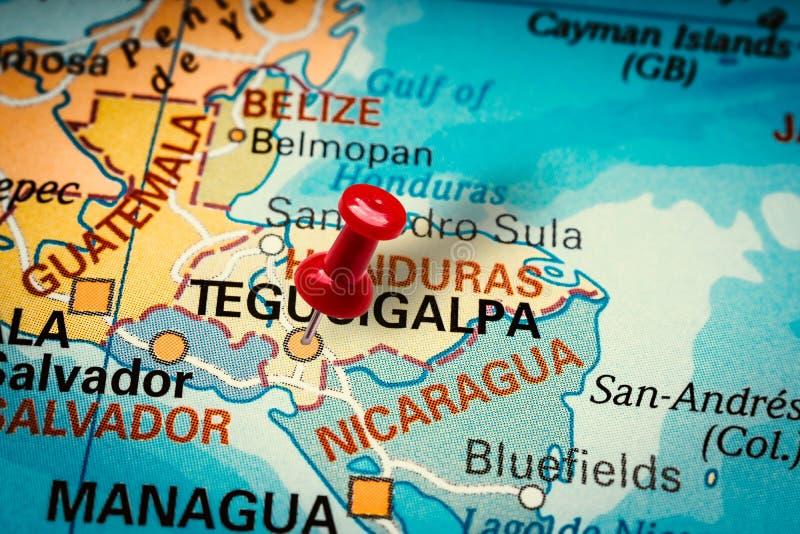 Pushpin pointing at Tegucigalpa city in Honduras. PRAGUE, CZECH REPUBLIC - JANUARY 12, 2019: Red thumbtack in a map. Pushpin pointing at Tegucigalpa city in stock photos