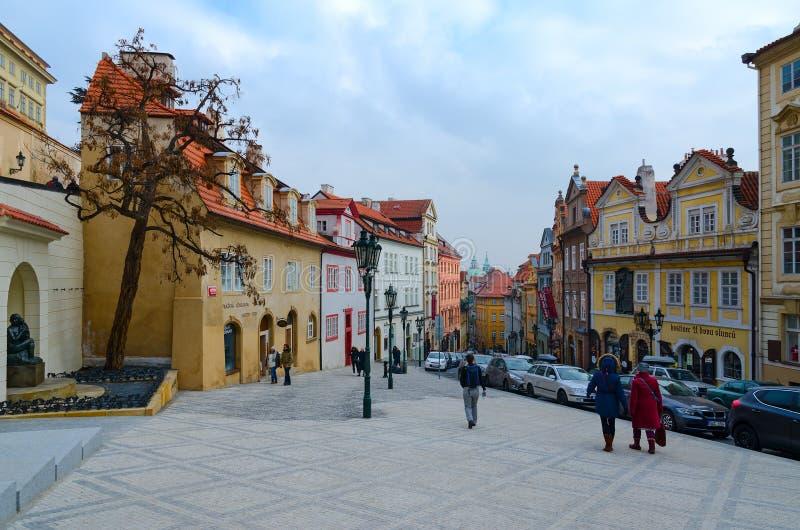 People walk along Nerudova Street in historic district of Prague Mala Strana, Czech Republic. PRAGUE, CZECH REPUBLIC - JANUARY 22, 2019: Unidentified people walk royalty free stock image