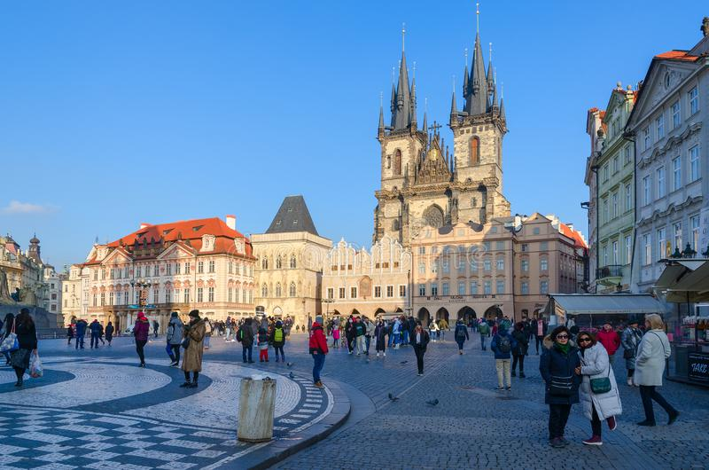 Tourists walk along Old Town Square in Prague, Czech Republic stock images