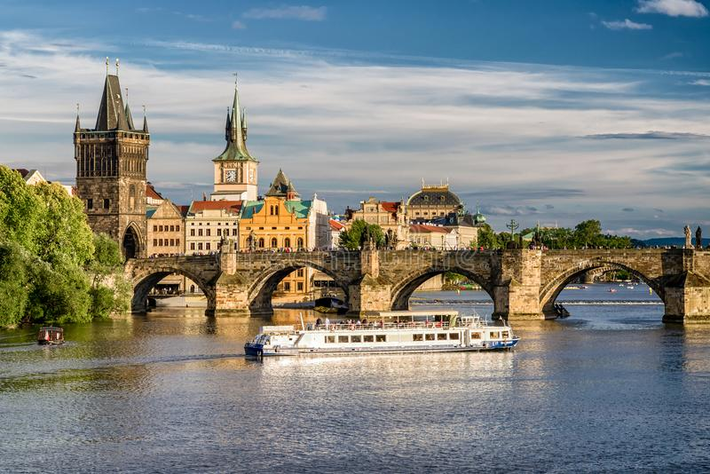 Charles bridge and cruiseship on river Vltava, Prague - Czech re stock photos