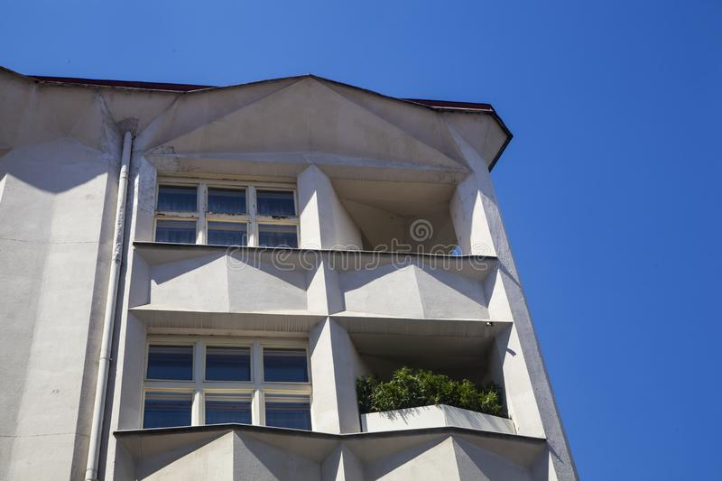 Facade with balconies. Prague, Czech Republic - July 14 2018: A facade with two balconies, the second one has greenery royalty free stock photo