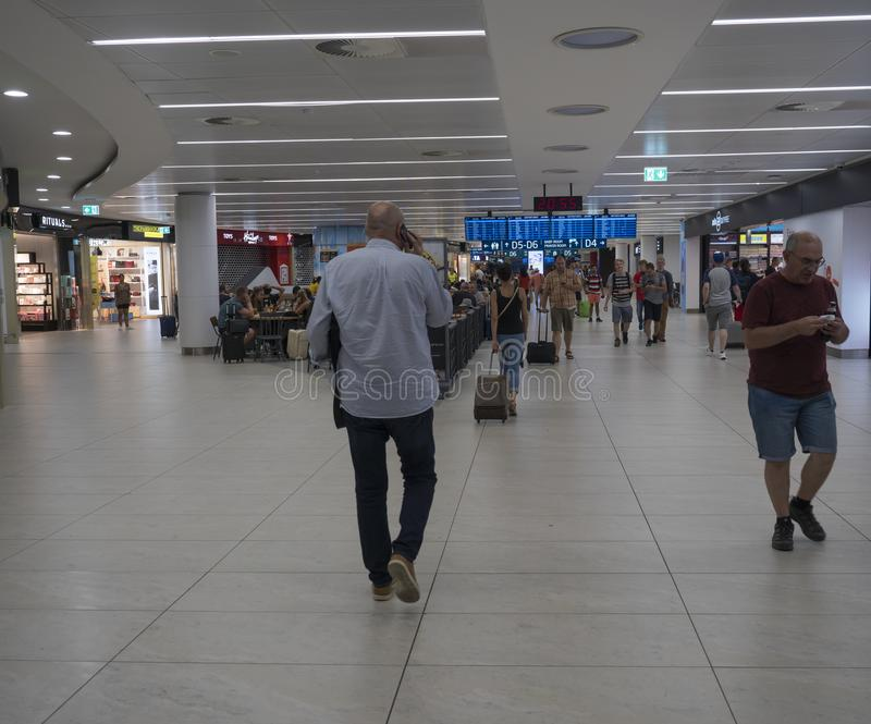 PRAGUE, CZECH REPUBLIC, July 29, 2019: People traveling and shoping in Aelia Duty Free shop on Prague Airport stock image