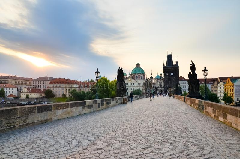 Prague, Czech Republic - June 27th 2019: Tourists on historical Charles Bridge in the early morning in sunrise light. Famous. Gothic site and popular tourist stock image