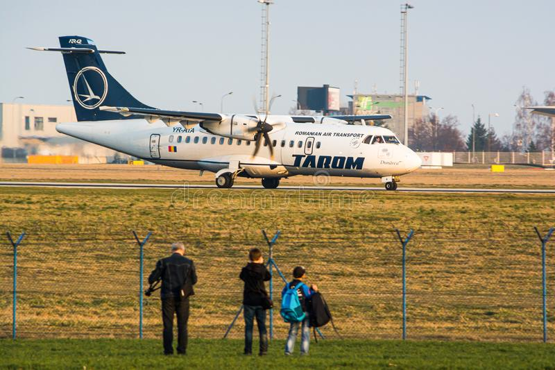 Prague, Czech Republic - March 14, 2014. People watching airplanes Landing and taking off at the airport stock images
