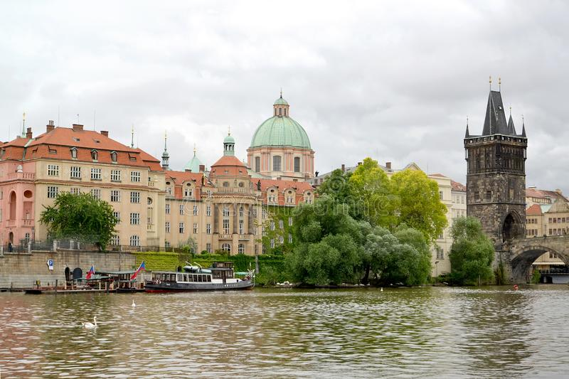 PRAGUE, CZECH REPUBLIC. A city landscape with the Bridge tower on the bank of the river of Vltava stock images