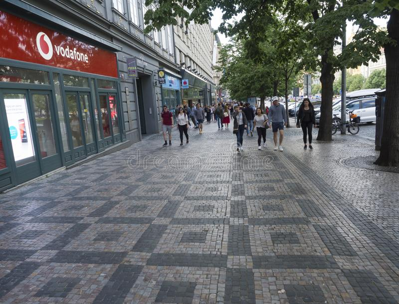 PRAGUE, CZECH REPUBLIC - MAY 18, 2019: Group of tourist people walking in Prague Wenceslas square in the historical royalty free stock photography