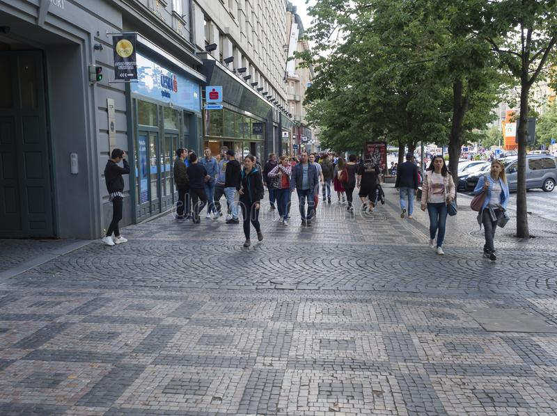 PRAGUE, CZECH REPUBLIC - MAY 18, 2019: Group of tourist people walking in Prague Wenceslas square in the historical royalty free stock images