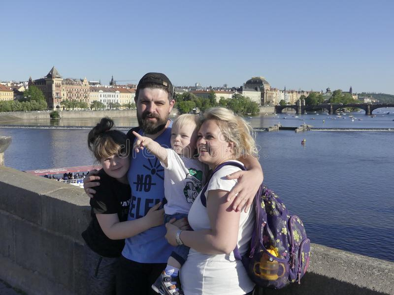 A happy family of tourists at Charles Bridge. The family travels stock image