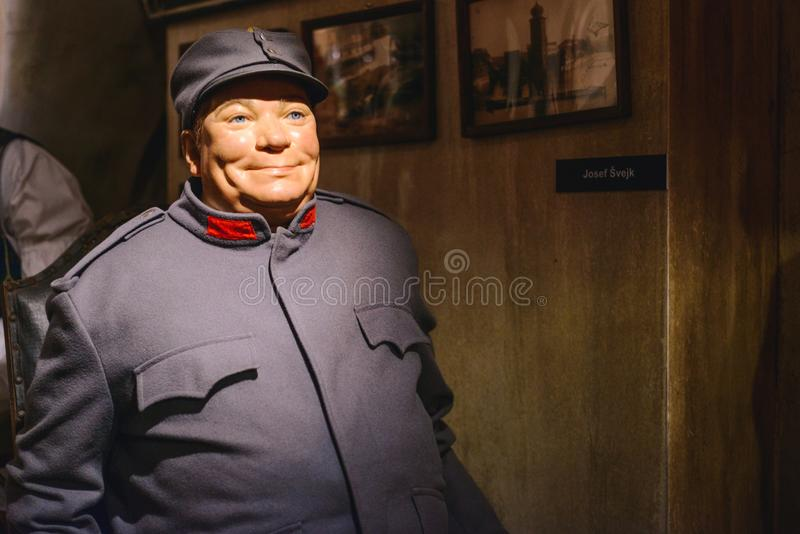 PRAGUE, CZECH REPUBLIC - MAY 2017: The wax figure of the soldier Schweik - protagonist of the satire, dark comedy novel by Jarosla royalty free stock image