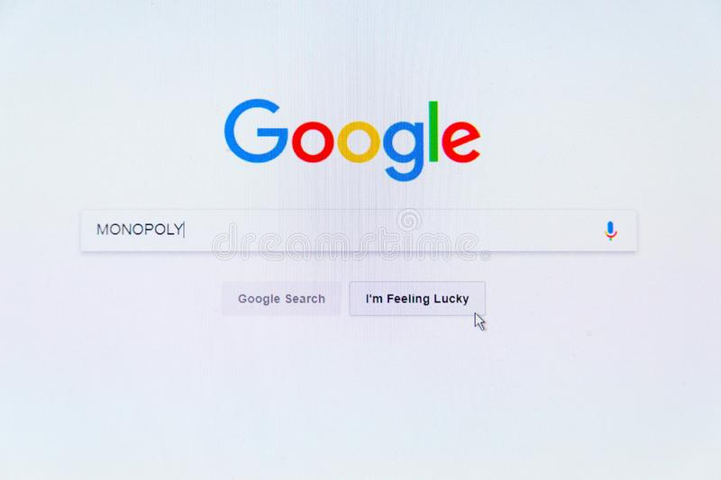Google American technology company logo on search engine homepage with word Monopoly in search bar stock photography
