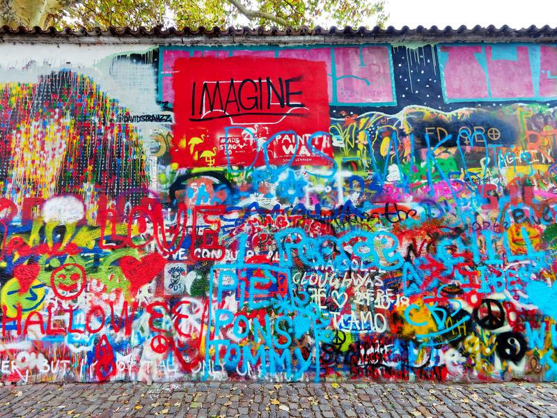 Prague, Czech Republic - October 31, 2018 Graffiti at John Lennon Wall. Since Communist days, this wall has been covered in royalty free stock images