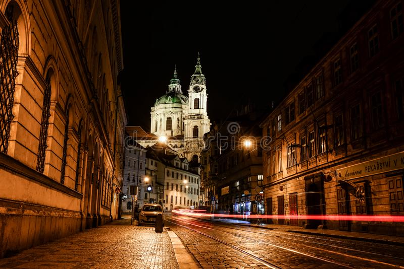 Prague, Czech Republic - October 7, 2017: Night view on St. Nicholas Church near Old Town Square and evening street of Prague, Cze royalty free stock photography