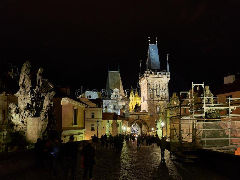 Prague, Czech Republic - October 30, 2018 A view of the entrance to Mala Strana or Lesser Town from Saint Charles bridge by night royalty free stock images