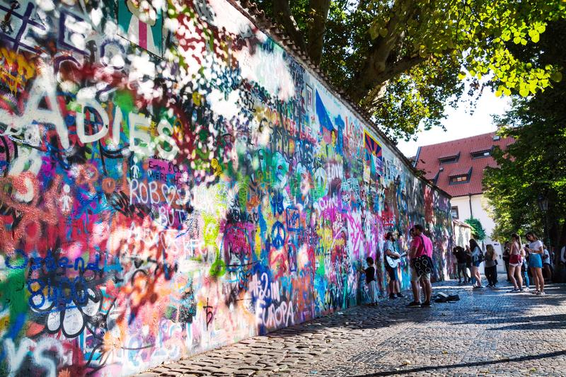 People in front of public graffiti Lennon Wall near Charles Bridge, Mala Strana in Prague, Czech Republic royalty free stock photos