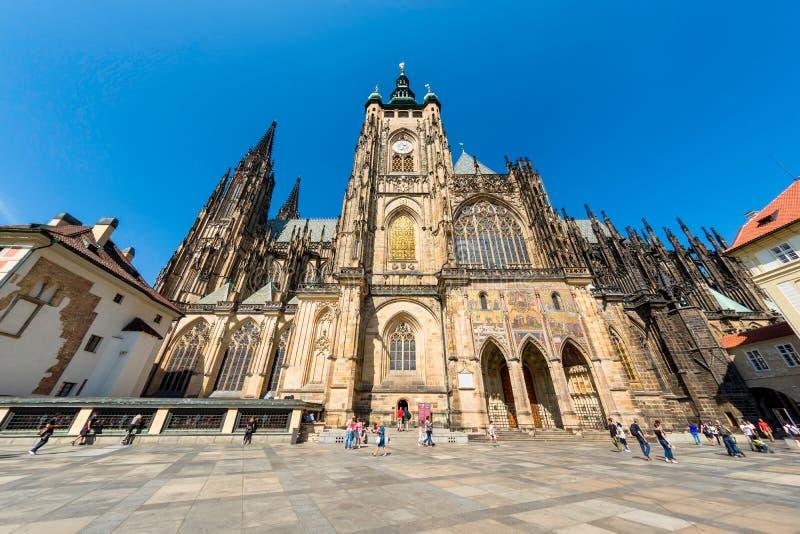 PRAGUE, CZECH REPUBLIC - SEPTEMBER 07, 2016: People walk around. Of Saints Vitus Cathedral royalty free stock photo