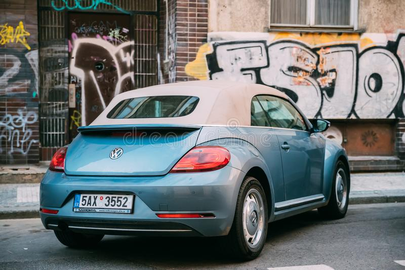 Side View Of Blue Volkswagen New Beetle Cabriolet Car Parked In Street. Prague, Czech Republic - September 22, 2017: Side View Of Blue Volkswagen New Beetle royalty free stock images