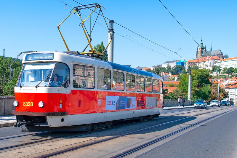 Tram in Prague crosses a bridge over the Vltava river stock images