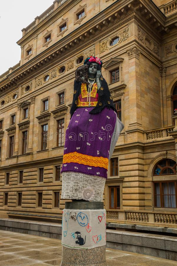 Prague, Czech Republic: statue of a woman at a theater in Prague. Residents wear clothes on the sculpture royalty free stock images