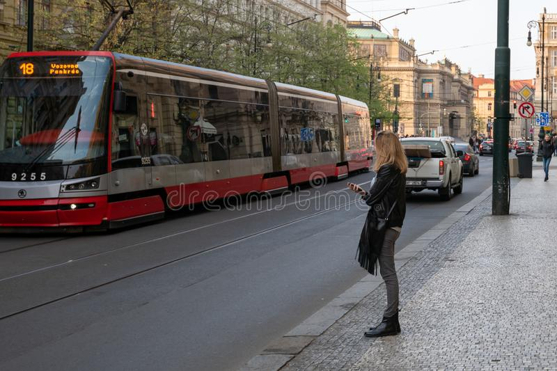 PRAGUE, CZECH REPUBLIC - 10TH APRIL 2019: Pragues new model of tram picks up customers in Spring stock image