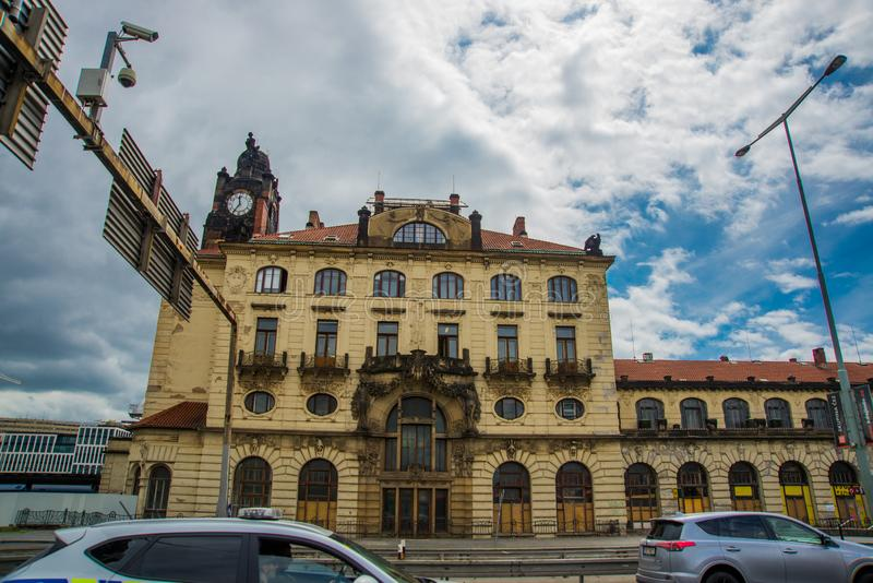 Prague, Czech Republic: Train station historical building in Prague, Czech Republic. Prague, Czech Republic: Cars passing by the main and biggest railway station stock photo