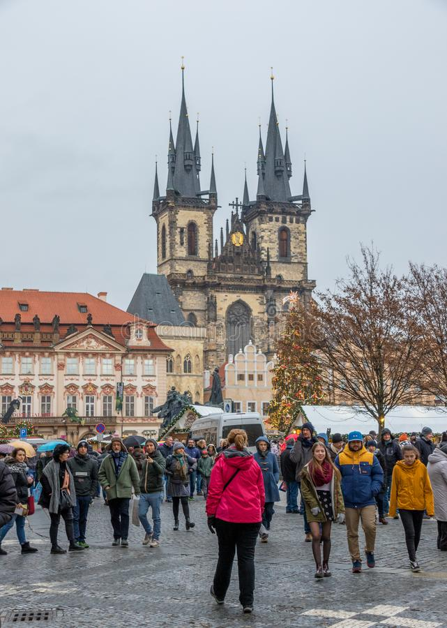 Tyn Church Old Town Square in Prague. Prague, Czech Republic - unidentified tourists flock to Old Town Square the heart of the city`s historic core stock image