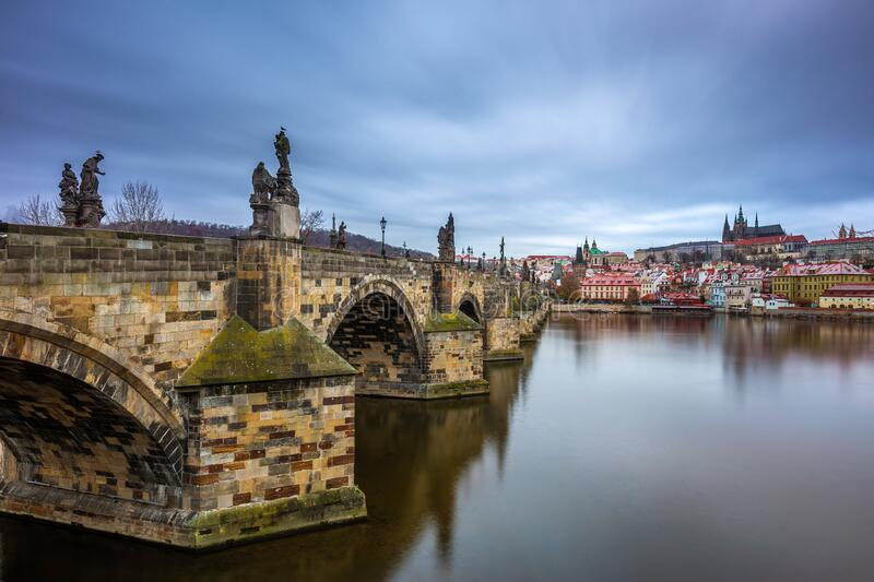 Prague, Czech Republic - The world famous Charles Bridge Karluv most with River Vltava and St. Vitus Cathedral. On a cloudy winter morning royalty free stock images