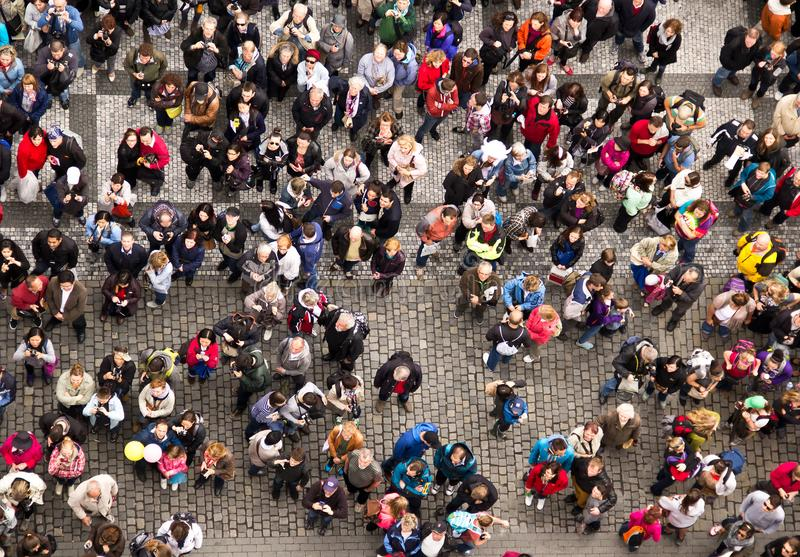 The crowd of people on the square in the center of Praque. People make photos of sight, view from above royalty free stock photo