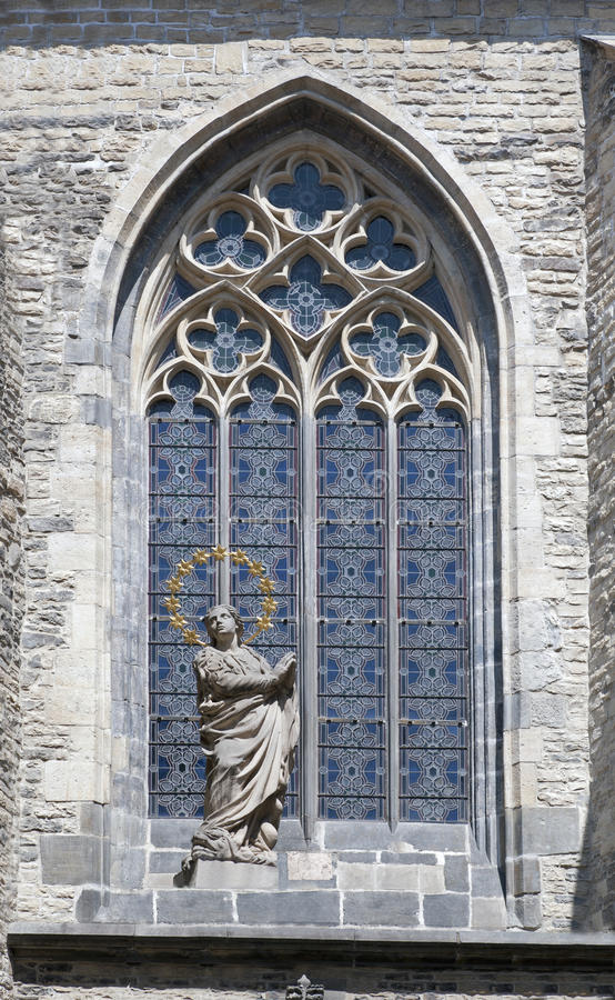 Prague - Gothic glass stained window. With the angel stock photography
