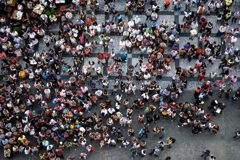 Aerial photograph of people gathered in a square. Aerial photograph of people visiting the Old Town Square in Prague. Bird`s eye view of crowd of people stock image