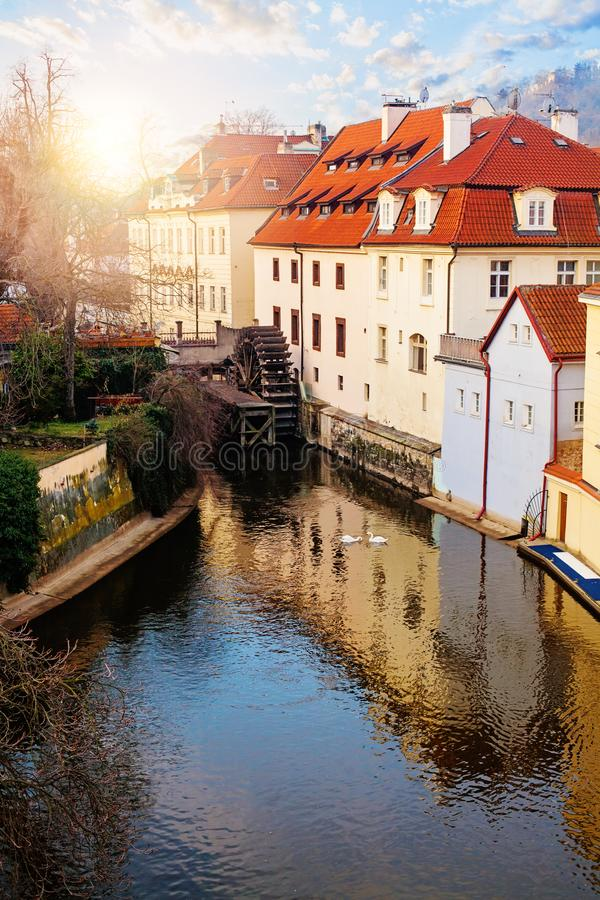Prague landmark. Certovka river and and old water wheel mill in Prague stock photo