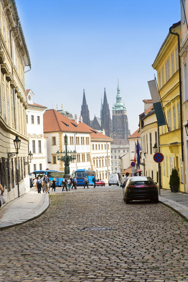 Prague, narrow street and spikes of the Cathedral.  stock photography