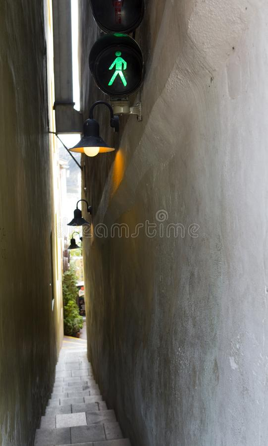 Prague. The narrowest street Vinarna Certovka, with the traffic light for pedestrians and one-way traffic stock photo