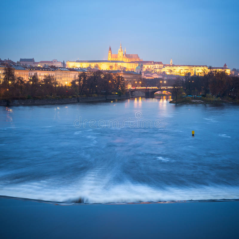 Prague at Night. Prague, Czech Republic - November 14, 2014: Late evening view of the river Vltava (Moldau) with the Prague Castle in the background royalty free stock images