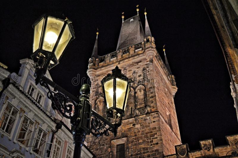 Prague old lanterns. Light, capital, dark, stone, edification, buildings, oldest, tower, city, cities, beautiful royalty free stock images