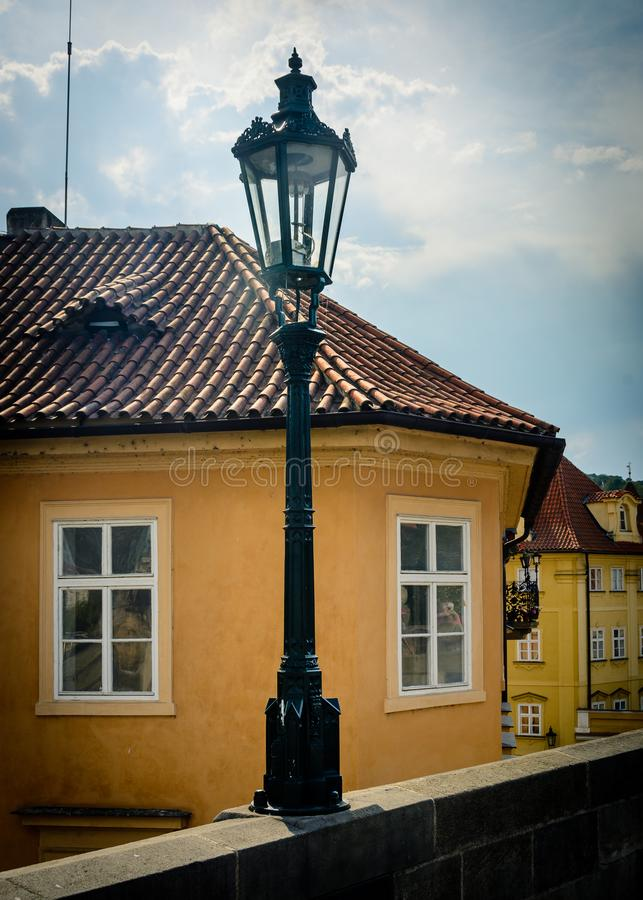 Prague - old street light on the Charles Bridge. The Czech capital, Prague, is beautiful in summer - take a walk over the Charles bridge in the center and admire stock image