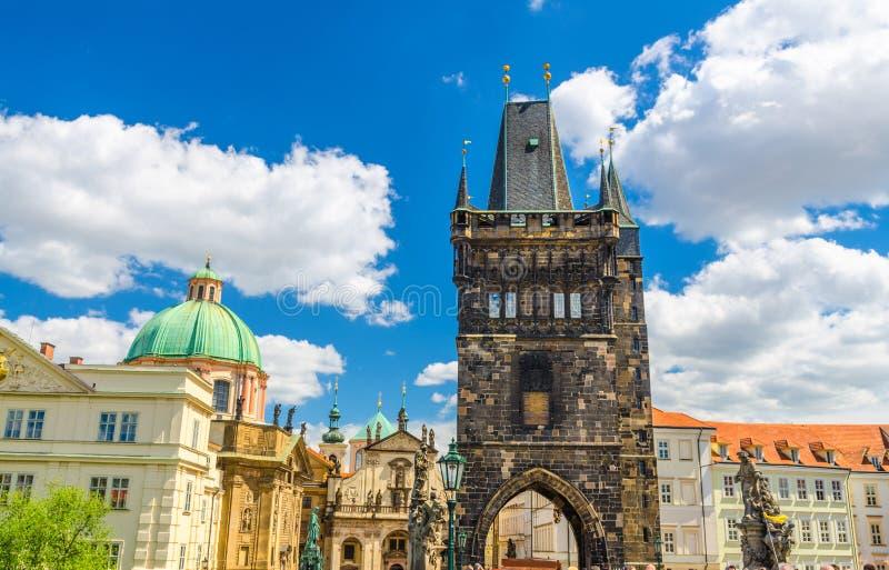 Prague Old Town Bridge Tower on Charles Bridge Karluv Most over Vltava, St Salvator Church in Klementinum stockbild
