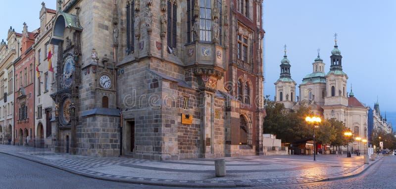 Prague - The Old Town hall, Orloj, Staromestske square and St. Nicholas church at dusk stock images