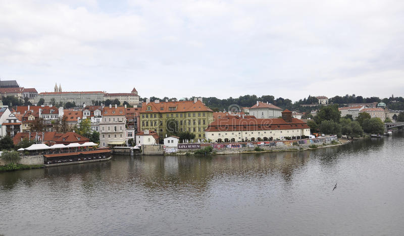 Prague Panorama and Kafka Museum over Vltava river in Czech Republic royalty free stock photography