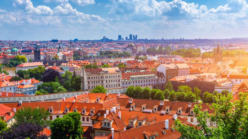 Prague red roofs and dozen spires of historical Old Town of Prague. Cityscape of Prague on a sunny day. Red rooftops, spires and stock photography